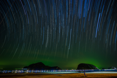 Star trails over the sea in rural of Thailand.