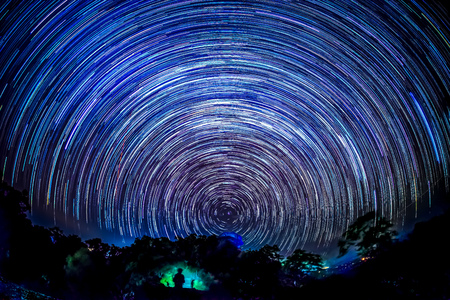 Star trails over national park in northern of Thailand. Stock Photo