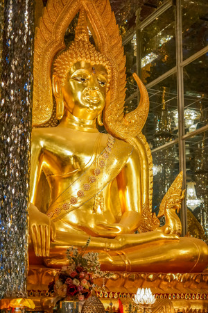 Golden Buddha image in church decorated with glass, Thailand Buddhist temple