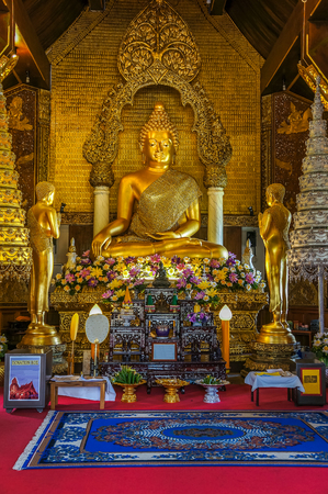 Buddha image with two disciple statues in church of ,Thailand Buddhist temple.