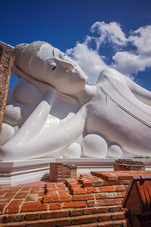 Reclining white Buddha image in Buddhist temple in Angthong of Thailand