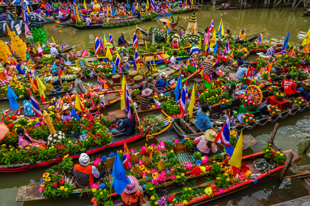 canal parade: AYUTHAYA, THAILAND - JULY 11, Buddhists do candle festival parade by boat at Ladchado canal in Ayuthaya, Thailand on July 11, 2014