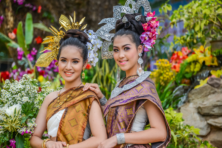 NAKORN PHANOM, THAILAND - FEBRUARY 14, 2015: Thai northeastern Phutai dancers with traditional costume  in Phutai world event day in Renunakorn of Nakorn Phanom, Thailand.