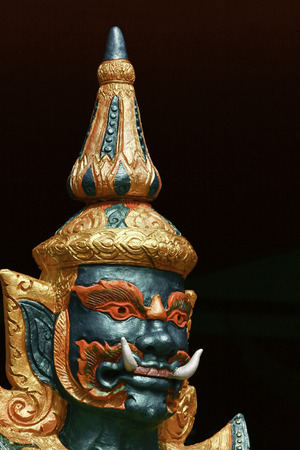 Thai literature giant with green face decorated in Buddhist temple