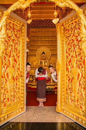 Ubonratchathani, Thailand-April 30, 2016: Three girls welcoming tourist to Buddhist church in Ubonratchathani, Thailand Editorial