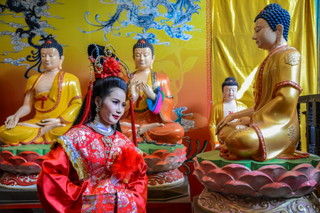 Chachoengsao, Thailand - July 14, 2013 : Beautiful woman with traditional chinese red dress in Chinese shrine in Thailand.