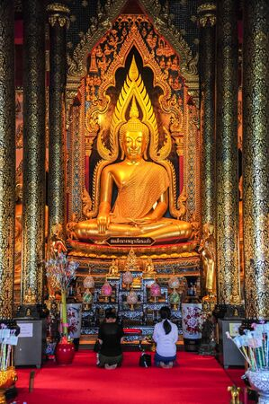 Phisanulok, Thailand - April 6, 2012 : Buddhists worshiping beautiful Buddha image in Buddhist church in Phitsanulok, Thailand