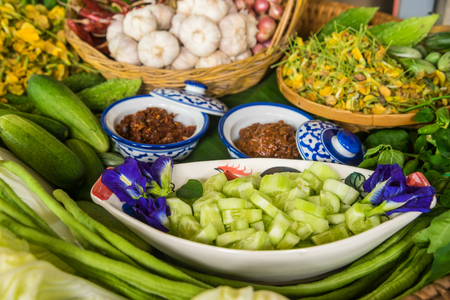 selectively: Various Thai vegetables, spices  and chilli sauce in basket, ready for cooking, selectively focus Stock Photo