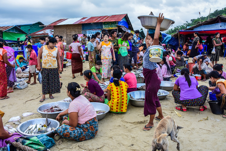 fish vendor: Dawei, Myanmar - July 12, 2015: Fresh market, where sellers and buyers meet to sell and buy fresh and raw food in Dawei, Myanmar Editorial