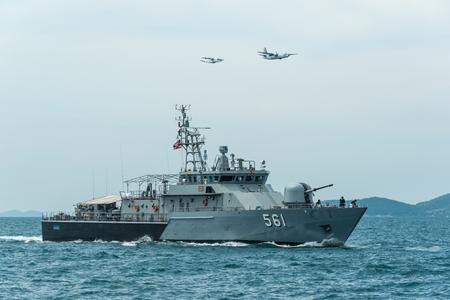 Pattaya, Thailand - November 9, 2017, Navy warships running on sea while warplanes flying above warships on the 50th anniversary ASEAN international fleet 2017 review drill in Pattaya, Thailand
