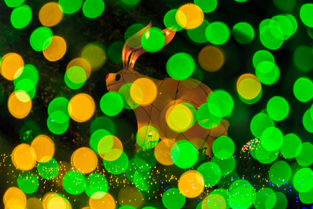 Abstract bokeh from light with rabbit figure decorated in Christmas and new year festival