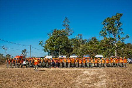 Nakhon Ratchasima, Thailand - December 23, 2017: Row of foresters trained to be paramedics for emergency service to tourists to rescue tourists in rescue drill at Khao Yai national park, Thailand Editorial