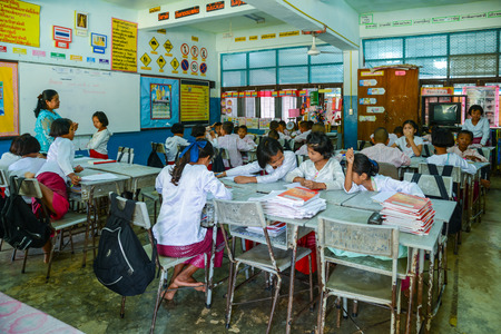Kanchanaburi, Thailand - July 22, 2016: Mon students with traditional dresses studying in classroom of government school in rural of Kanchanaburi, Thailand Редакционное
