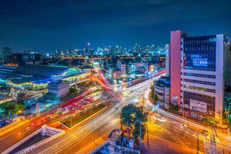 Cityscape of Bangkok and traffic during twilight at Hualampong Railway Station area in Bangkok, Thailand