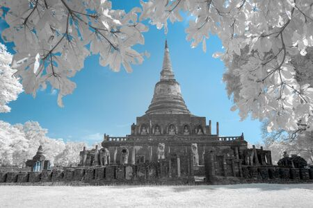 Ruined ancient Buddhist temple and pagoda in Srisatchanalai historical park, Sukhothai, Thailand in infrared photography Stock Photo