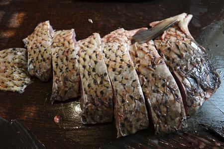 Freshly peeled carp fish on the table