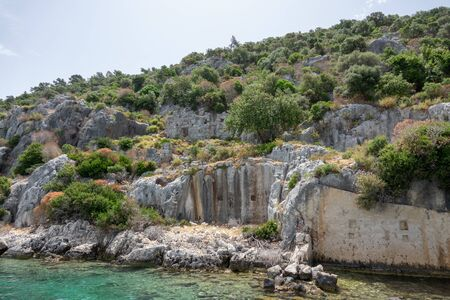 Ruins of sunken ancient city of Dolichiste on the northern part of the Kekova Island. Devastating earthquake in the 2nd century AD