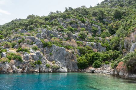 Ruins of sunken ancient city of Dolichiste on the northern part of the Kekova Island. Devastating earthquake in the 2nd century AD Reklamní fotografie
