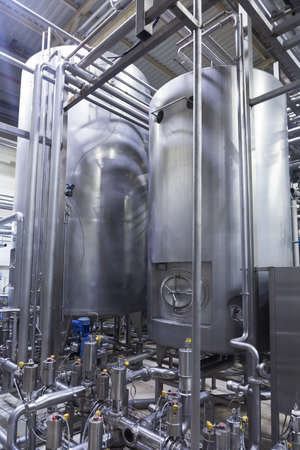 Industrial interior of an alcohol factory with silo
