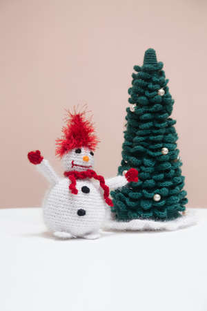 handmade knitted snowman with a Christmas tree