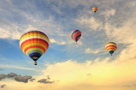 sunny day: Colorful balloons rising up during sunset