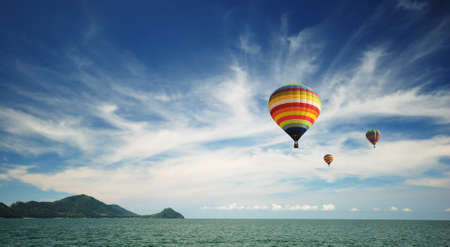 Beautiful hot air balloon over cloudy blue sky Stock Photo