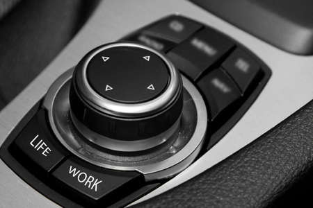 CAR JOYSTICK SYMBOLIZING UNCERTAINTY AND DIFFICULT CHOICE BETWEEN WORK AND FAMILY photo