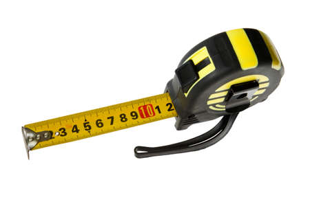 Measurement tool ruler tape stretched out to 12 santimeters close up view from above left