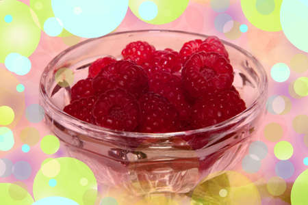 Close-up of raspberry juicy and colourful intended to bring pleasure and happiness which is represented by pastel colours all around