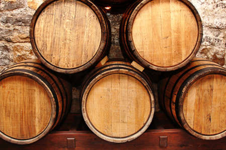 wine barrel: storage of oak wine barrells in a cellar Stock Photo