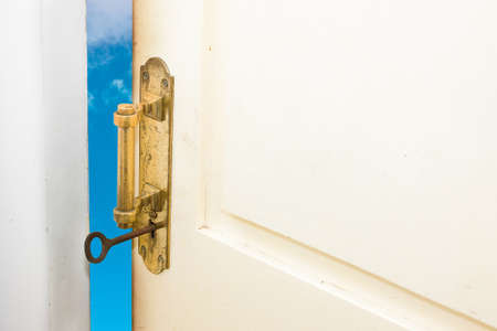 Better life, success, career development, challenge concepts represented by half-opened door to the blue sky Stock Photo - 10873958
