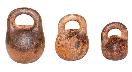 iron vintage rusty weights of different mass Stock Photo
