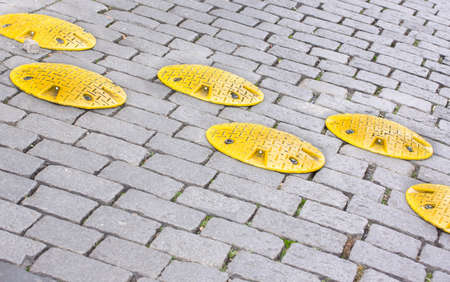 Road speed bump - a safety restriction to prevent people from fast driving