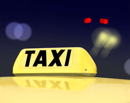 Taxi sign at night traffic photo