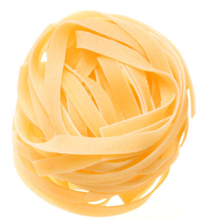 Nest of yellow italian macaroni isolated on white - selective focus on upper front part