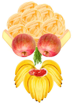 Funny food head made of natural components mostly fruits and veggies - its hair made of italian pasta, its face made of such ingredients as french cheese, green dill, meat chop, bunch of bananas