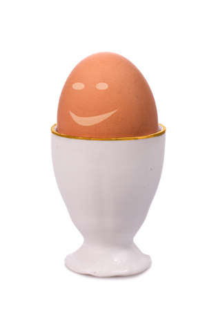 fresh happy egg in eggcup Stock Photo