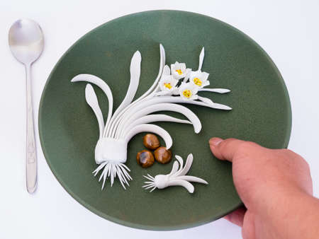 Dish decorated with flowers, which are handmade. Art is beautiful pottery photo