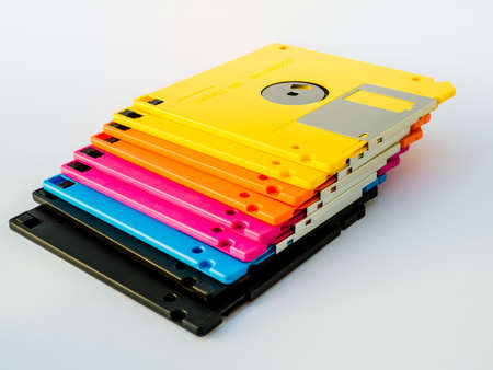 old document: A floppy disk, or diskette, is a disk storage medium composed of a disk of thin and flexible magnetic storage medium, sealed in a rectangular plastic carrier lined with fabric that removes dust particles. Stock Photo