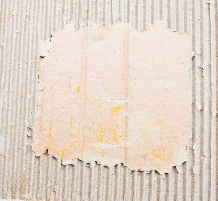 torn edges: old textured cardboard sheet with torn edges Stock Photo