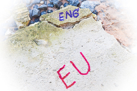 yes or no to euro: Brexit UK EU referendum concept with word UN and Eng on stone wall