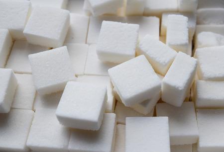 refined: Refined cube sugar background Stock Photo
