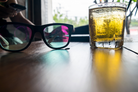 glasses on wooden table with notebook Stock Photo
