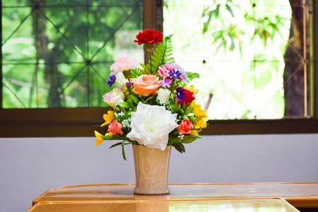 Beautiful spring flowers in a glass vase on meeting room,businees room