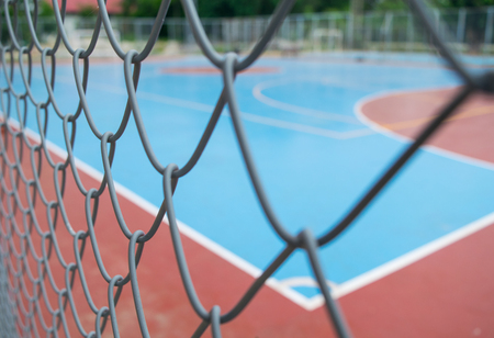 blur and soft focus steel net with empty futsal court