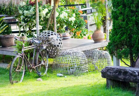 rural road: Old thai bikecycle on green grass Stock Photo