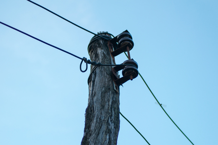 telephone poles: old electricity wooden pole