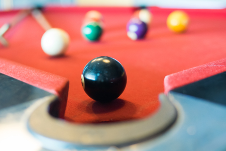 black ball of snooker on snooker table