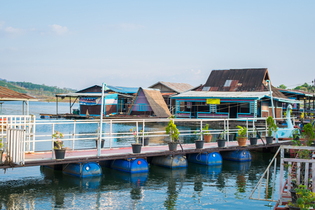 floating house near river in Kanchanaburi thailand