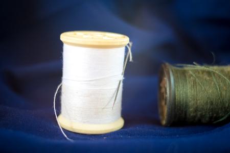 castles needle: thread with needle on blue fabric